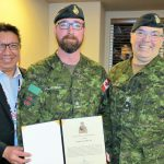 Major Charles Ohlke (centre) receives commendation from Grand Chief Alvin Fiddler (left) of Nishnawbe Aski Nation and Brigadier-General Jocelyn Paul (right)