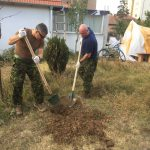 Members of Task Force Pristina prepare the ground for tree planting
